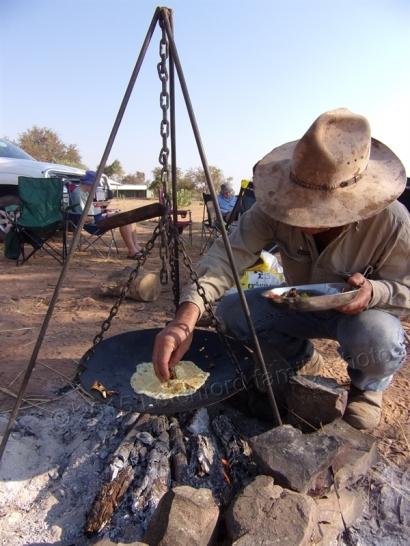 Peter cooking an omelette on a campfire at Home Valley.